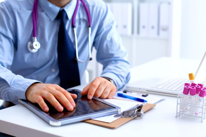 State Audit - Doctor preparing paperwork